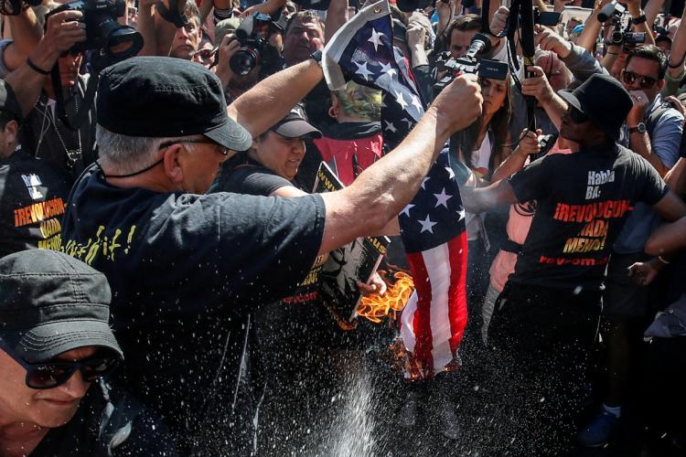 Communists Arrested After Burning American Flag