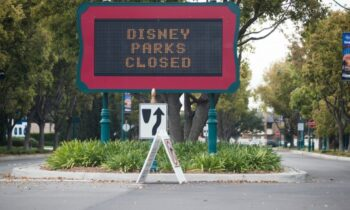 Disney May Check Guests' Temperatures When Parks Reopen – Stock Downgraded Over Dim Forecast