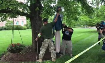 Right-Wing Protestors Condemned For Hanging Effigy Of Governor From A Tree